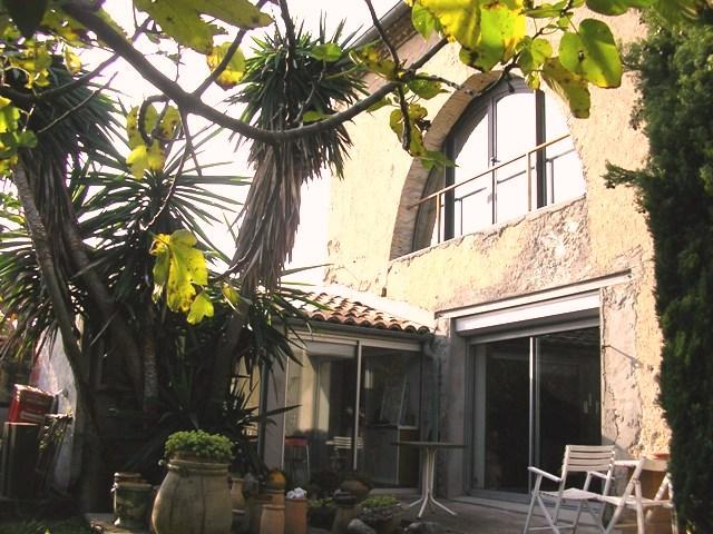 Très beau loft avec jardin dominant la ville